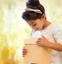 30895086-happy-child-girl-with-gift-box